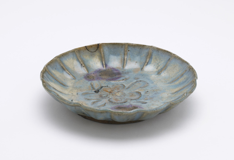 Dish with molded decoration