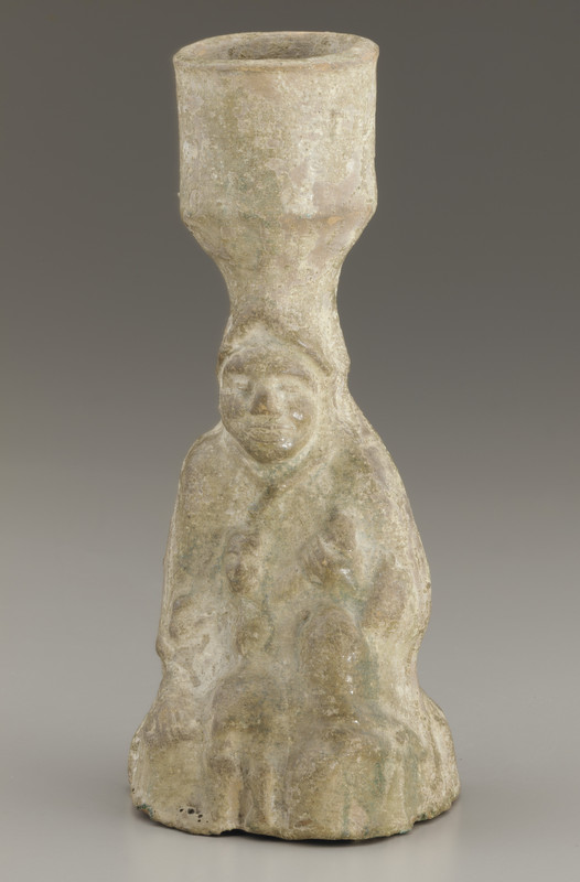 Tomb lamp in the form of a seated figure holding a child
