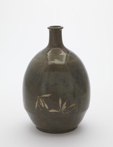 Bottle with inlaid design of orchids