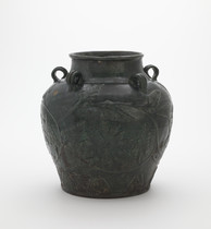Jar with five loop handles and relief floral vinescroll decoration